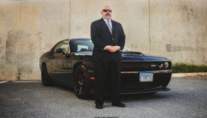 pic of Michael Bruckheim, Rockville DUI lawyer next to car